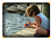 Fishing from the boat dock Online Jigsaw Puzzle for Kids